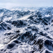 Stock Photo: Aerial View of Craggy Snow Covered AlaskMountain Range