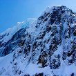 Aerial View of a Craggy Snow Covered Alaskan Mountain Peak — Stock Photo