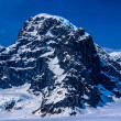 Stock Photo: Aerial View of Craggy Snow Covered AlaskMountain Peak