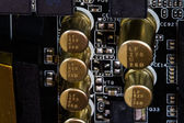 High Tech Capacitors on Computer Motherboard. — Stock Photo