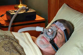 Senior Adult Wearing CPAP in Bed — Stock Photo