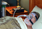 Senior Adult Wearing CPAP in Bed with Oxygen — Stock Photo