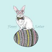 Vector easter rabbit sitting on egg — Stockvektor