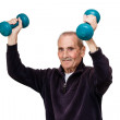 Senior male doing exercises with dumbbells on white — Stock Photo