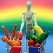 Conceptual man, meat, vegetables,on bright rainbow background — Stock Photo