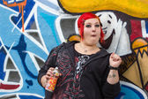Femaly graffity sprayer with funny face — Stock Photo