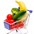 Mixed fruit and vegetables in a mini shopping cart, isolated on  — Stock Photo