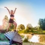 Woman enjoying morning exercises — Stock Photo