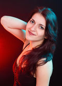 Natural beauty brunette woman in red and blue light — Stock Photo