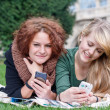 Network. Teen girls with smartphones. — Stock Photo