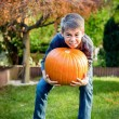 Boy holding big pumpkin — Stock Photo