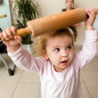 Funny girl with rolling pin — Stock Photo