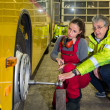 Woman, trainee, working in the bus Workshop — Stock Photo