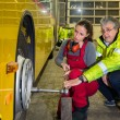 Stock Photo: Woman, trainee, working in the bus Workshop