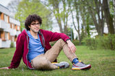 Young man chilling on the lawn in the city — Stock Photo