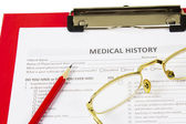 Medical claim form and patient medical history questionnaire — Stock Photo