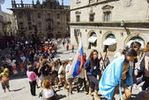 Catholic pilgrims come up to St. James Cathedral on Saint James Day in Santiago, Spain. — Stock Photo
