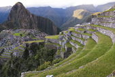 Ancient Inca lost city Machu Picchu in the evening. — Stock Photo