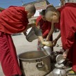 Stock Photo: Buddhist nuns pour public tibetteat 4-days pujceremony in Leh, Ladakh, India.