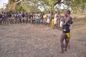 Hamer people dance traditional dance at the festival dedicated to initiation rite for young men. — Stock Photo