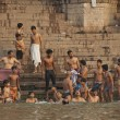 Indian people bathe in Ganga river in Varanasi, India. — Stock Photo
