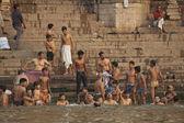 Indian people bathe in Ganga river in Varanasi, India. — Stock Photo