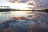 Sunset reflection in the Lake Pocha on Russian North. — Stock Photo