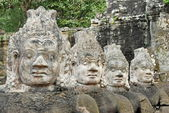 Ancient Hindu statues lined in Angkor Wat temple complex. — Stock Photo