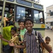 Indian children get on a school bus after visiting a church service in Vizhinjam, Kerala, India. — Stock Photo #30127845