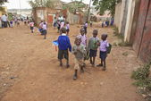 Young school boys go home down a street in Kibera, Nairobi, Kenya. — Stock Photo