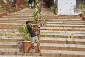Indian boy plays cricket on ghat in Varanasi, India. — Stock Photo