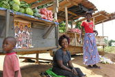 Ugandian women sell vegetables on the road near Masindi, Uganda. — Stock Photo