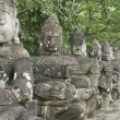 Ancient Hindu statues lined in Angkor Wat temple complex. — Stock Photo #30579727