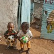 African school kids play with balls on a street  in Kibera, Nairobi, Kenya. — Stock Photo
