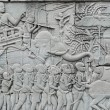 Bas-relief on a wall of an ancient temple in Angkor. — Stock Photo