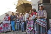 Quechua women watch traditional dance at harvest celebration in Chivay village, Arequipa region, Peru. — Stock Photo