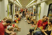 Spanish fans ride the subway to see the TV translation of the final match of the World Cup 2010 at the stadium in Valencia. — Stock Photo