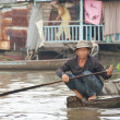 Vietnamese man paddles on a water street in Mekong Delta area, Vietnam. — Stock Photo