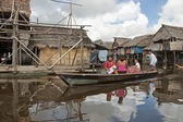 Peruvian family in traditional boat float on water street in Belen, Iquitos, Peru. — Stock Photo