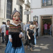 "Unidentified person dressed as ""cabezudo"" walks on a street in Santiago de Compostela, Spain. — Stock Photo"