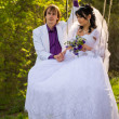Bride and groom swinging on a swing — Photo