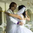 Stock Photo: Bride and groom dancing the first dance at their wedding day