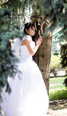 Happy Bride smiling near summer tree outdoors — Stock Photo