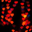 Defocused background lights or bokeh in the form of heart — Stock Photo