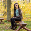 Stock Photo: Girl sitting on bench outdoors