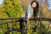 Young pretty woman in autumn park — Stockfoto