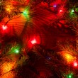 图库照片: Christmas lights on wooden background