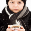 Woman with cup of coffee in the winter park — Stock Photo