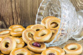 Closeup of a group of assorted bagels on a wood table top with b — Stock Photo