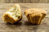 Tasty cupcake on wooden table — Stock Photo